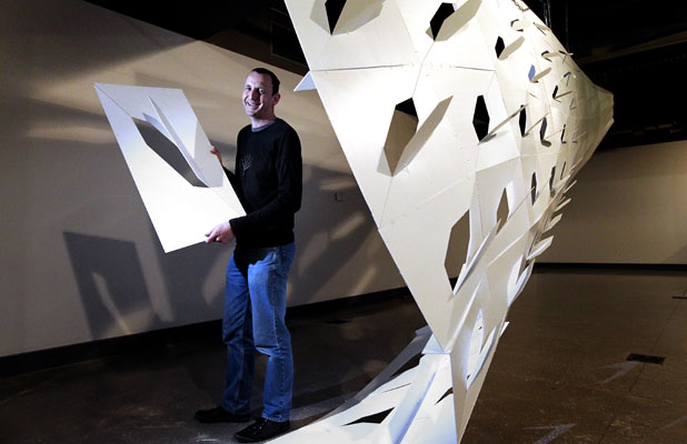 Victoria University School of Architecture programme director Mark Southcombe with his installation ''Creature'' at Puke Ariki.