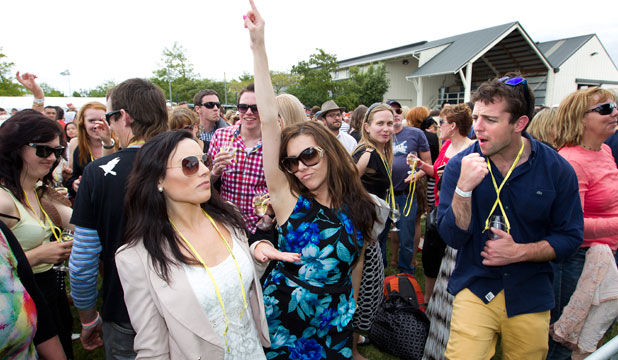Toast Martinborough festival-goers dance to the music of the Beat Girls at Palliser Estate.