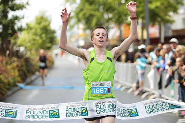 FAMILY MATTERS: Hamilton's Oliver McLean triumphantly crosses the finish line, followed by dad