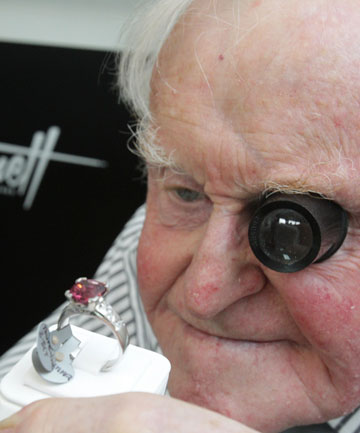 Tony Kennett, 83, a third-generation watchmaker of the family business Kennetts Jewellers, inspects a ring in their newly-opened shop in Sydenham.
