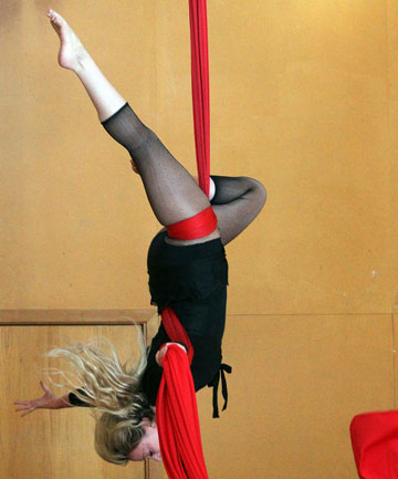 Acrobat Shelly Dingwall performs as Madam Gigi in the Christchurch Ci