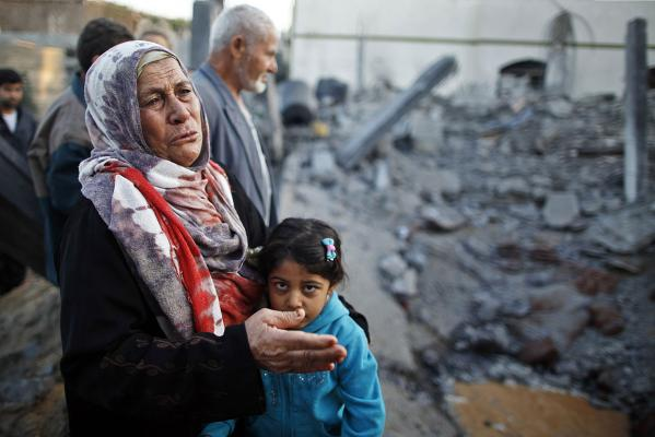 A Palestinian woman cries next