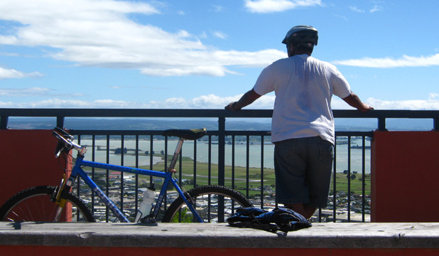 WATCHFUL: The author at a favourite spot in Nelson after a sport of cycling.