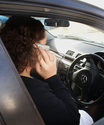 Motorists talks on a mobile phone.