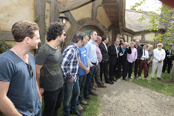 Prime Minister John Key with the Hobbit cast members at the Green Dragon at the Hobbiton film set in Matamata.