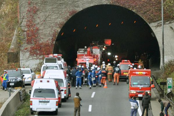 Emergency services converge on the entrance to the Sasago Tunnel near Tokyo.