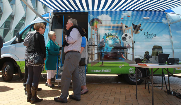 New Brighton residents admire one of the Christchurch City Council's two new mobile library vans