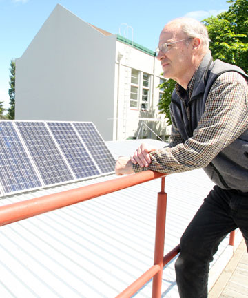 Michael Thomas with the new solar panel array installed at SIT's renewable energy centre.