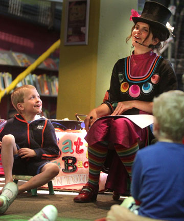 Storyteller Tanya Batt works on creating a new illustrated story with an enthralled Sean Barker, 6, and friends at Puke Ariki on Sunday.