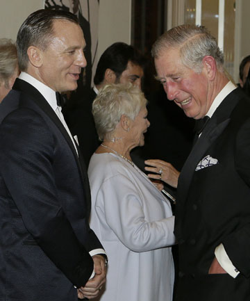 Britain's Prince Charles talks to actors Daniel Craig as
