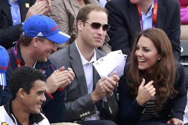 Peter Phillips, Prince William and Kate Middleton, Duchess of Cambridge talk as they attend the Eventing Jumping equestrian event at the London 2012 Olympic Games.