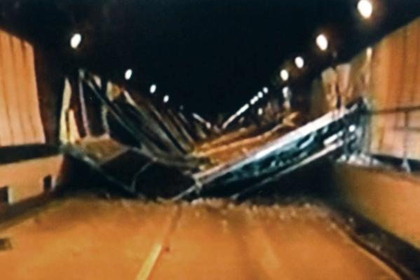 An image taken off video footage shows collapsed concrete ceiling panels inside the Sasago Tunnel on the Chuo Expressway in Koshu, Japan.