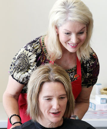 Volunteer Denise Leighs applies makeup to cancer patient Vicki Wright