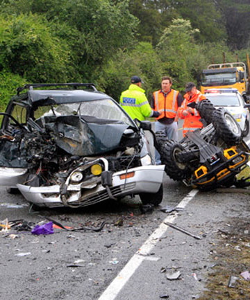 CRASH SCENE: Police and fire brigade officers attend the scene of the crash near the Pelorus Bridge.