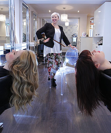 HAIR FOR HOLLY: Holly Cartmell at her Tinakori Rd salon in Wellington, with Antoinette Kavanagh, left, and Sam Wood.