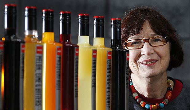 GROWTH CURVE: Tami Louisson with some of the syrups that Shott makes from New Zealand honey and fruits. A group of three Wellin