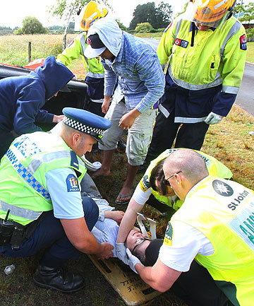 REALITY CHECK: Youths involved in the Right Track  Programme look on at a mock crash in Hamilton on Saturday as emergency services free the ''injured'' occupants.