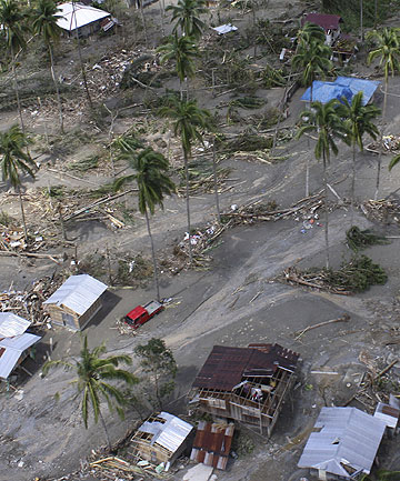 An aerial view of houses damaged by flash floods caused by Typhoon Bop