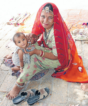 COLOURFUL DIVERSION: Gypsy women have trinkets, sitars and puppets for sale on the streets of Jaisalmer.