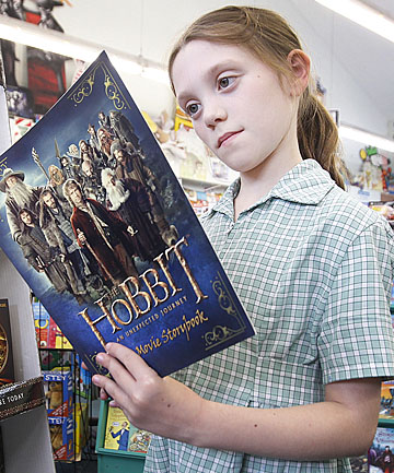 Emily Nicholson,  9, from Roseneath, checks out The Hobbit books at The Children's Bookshop in Kilbirnie