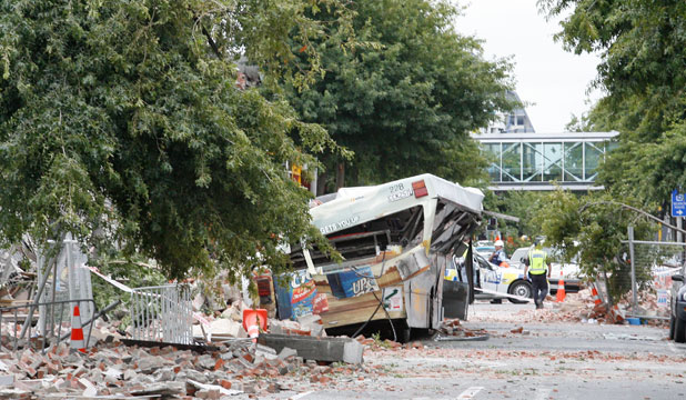 The wreckage of a two-storey Colombo St building and remains of a smashed bus after the February 22, 2011, earthquake.