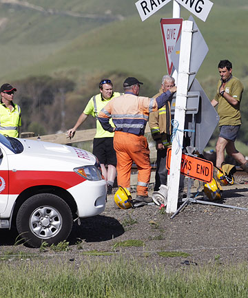 AT THE SCENE: Emergency services and KiwiRail workers at a rail crossing north of Woodville where a light truck was hit by a freight tra