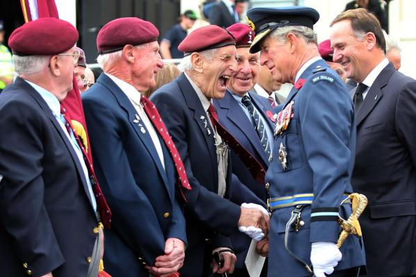 Prince Charles enjoys a moment with a Kiwi veteran from the British Airborne Forces during the Armistice Day commemorations outside the Auckland War Memorial Museum.