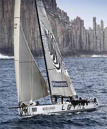 Investec Loyal sails past Tasmania's iconic Organ Pipes on the way to winning the 2011 Sydney to Hobart yacht race.