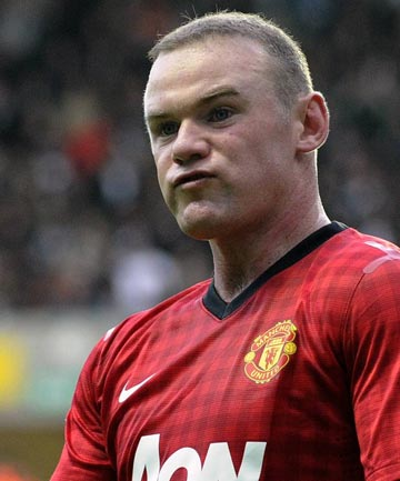 Manchester United star Wayne Rooney to miss 2-3 weeks of play because of a knee injury.