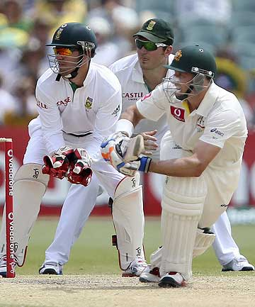 Australia's Mike Hussey (right) plays a shot during the fourth day's play of the second test cricket match against South Africa at the Adelaide Oval.