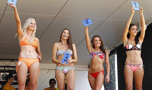 NUMBERS UP: Miss Whangamata entrants wave their numbers in the air, from left, Tahlia Kerridge, Sarah Choat, Jazmine Seales and winner, Tyler Handcock.