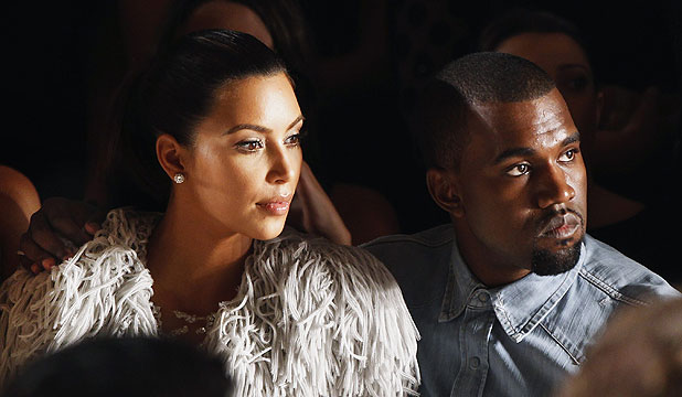 US rapper Kanye West (right) drapes his arm over the shoulder of reality TV star Kim Kardashian back in September 2012.