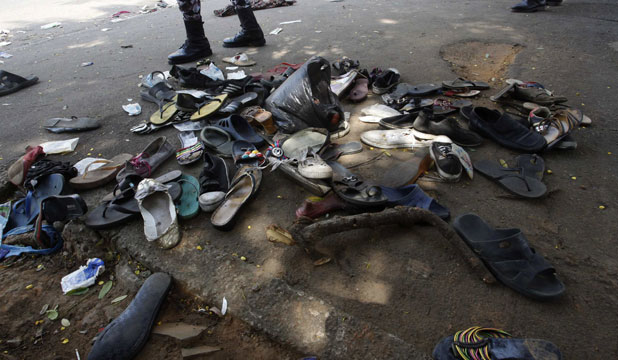Shoes are seen along a street in Plateau district where a stampede occurred after a New Year's Eve fireworks display in Abidjan, crushing over 60 people to death.