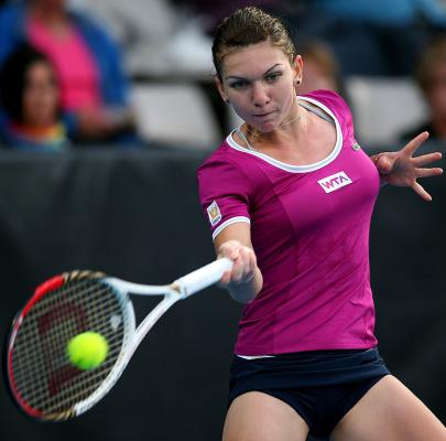 Simona Halep of Romania plays a forehand in her second round match against Agnieszka Radwanska of Poland during day three of the 2013 ASB Classic in Au