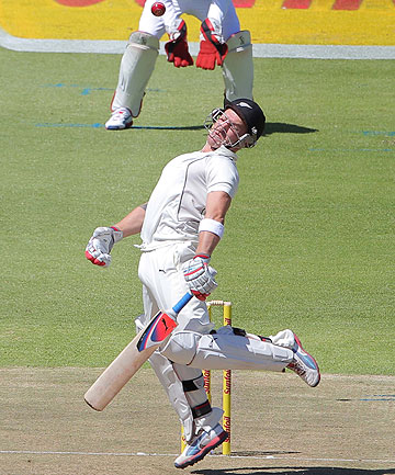 New Zealand captain Brendon McCullum takes evasive action from a Dale Steyn delivery on the first day of the first