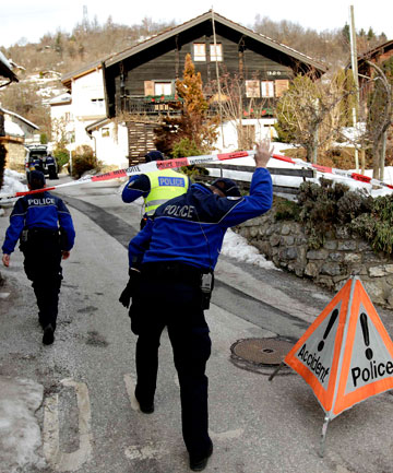 Police enter the crime scene in the Swiss village of Daillon