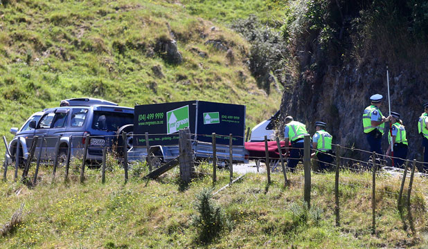 A body is removed from the accident scene involving a cyclist in Ohariu Valley Rd.