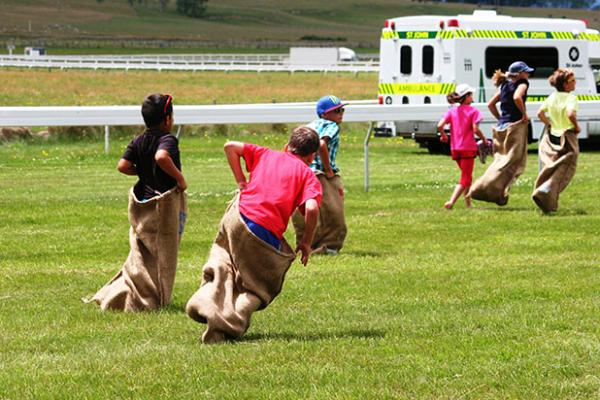 3-2-1 TIMBER: A competitor in the kid's sack race at the Taupo races is captured mid-fall.
