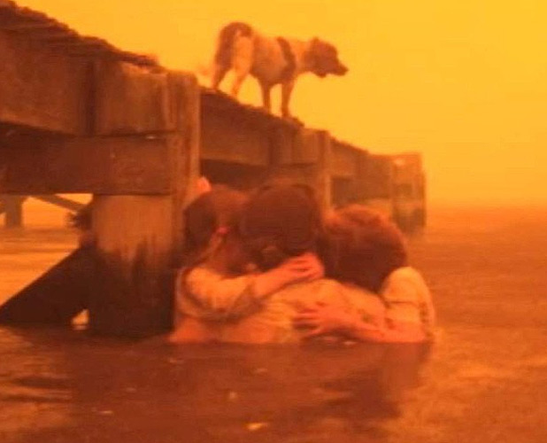 SHELTER: Tim and Tammy Holmes had to take their grandchildren into the sea to escape the flames.