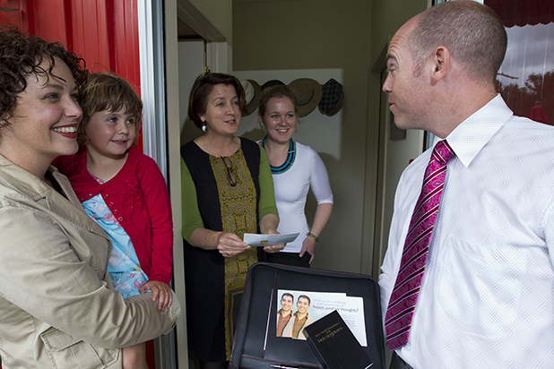 DOOR KNOCKING: Doug Cochrane, right, visits homes inviting people to the Jehovah's Witnesses conference this weekend that will be attended by 10,000 members. Kylie Cochrane, left, Mia Cochrane, Belinda Rowe, and Emerald Rowe listen intently.