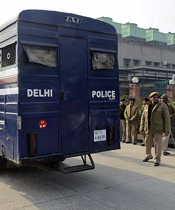 GOING TO COURT: A police van carrying five men accused of the gang rape and murder of an Ind
