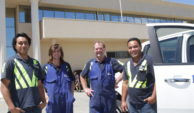 Blake Surfacings managing director Peter Scott, second from right, has been searching for someone to fill a position at his industrial flooring firm for six months. With him are employees, from left, Zedekiah Hunter, Joseph Scott and Star Esera. He has been unsuccessful in recruiting more staff.