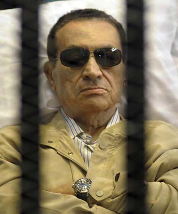 RETRIAL: Former Egyptian President Hosni Mubarak sits inside a cage in a courtroom in Cairo last year.
