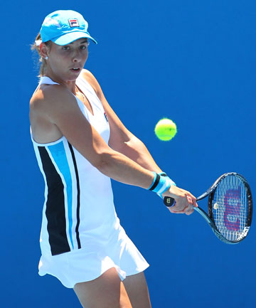 Marina Erakovic plays a backhand during her match against Alize Co