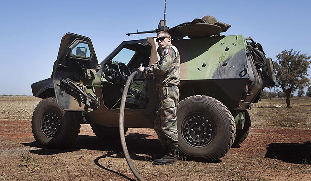 FUELLING UP: A French soldier refuels an armoured vehicle at a Malian air base in Bamako.