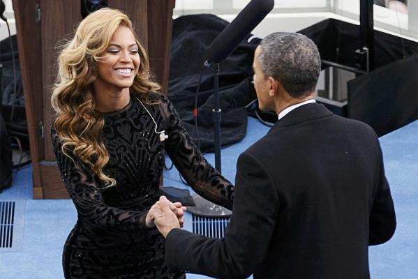 Singer Beyonce is greeted by Barack Obama after her performance during inauguration ceremonies.