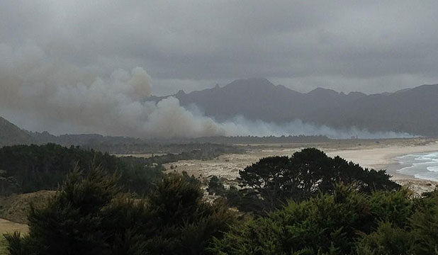 BLAZE ON BARRIER: A massive scrub fire burns in the Kaitoke beach area of Great Barrier Island.