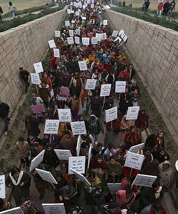 Women carrying placards enter Raj Ghat to attend a prayer ceremony for a rape victim after a rally organised by Delhi Chief Minister Sheila Dikshit protesting for justice and security for women, in New Delhi.