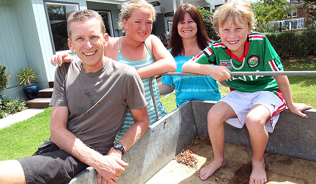 BRING IT ON: Fifty-nine hectares of joy in the country await Aucklanders, from left, Dr Harley Aish, Jemma, 10, Sara Aish and Caleb, 9.