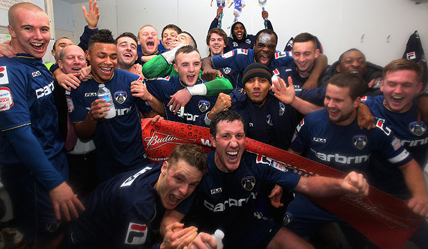 Oldham players celebrate after their shock win over Liverpool in the fourth round of the FA Cup at Boundary Park.